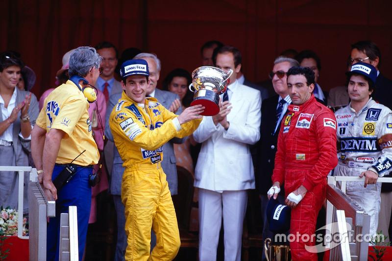 Podium: race winner Ayrton Senna, Team Lotus, third place ...