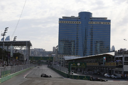Fernando Alonso, McLaren MP4-31 and team-mate Jenson Button, McLaren MP4-31