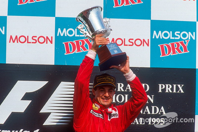 Jean Alesi, 1st position, celebrates his maiden Grand Prix win on the podium