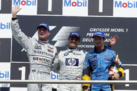 Formula 1 Photos - Podium: David Coulthard, McLaren Mercedes; Juan-Pablo Montoya, BMW Williams; Jarno Trulli, Renault F1 Team