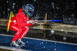 Dominik Kraihamer plays in the snow on pitlane