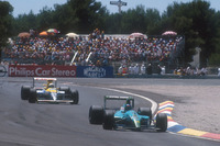 Formula 1 Photos - Ivan Capelli, Leyton House CG901 Judd takes the lead of the race for the first time, with Riccardo Patrese, Williams FW13B Renault lying 2nd behind him