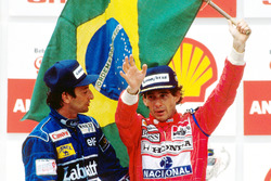 Podium: race winner Ayrton Senna, McLaren, second place Riccardo Patrese, Williams