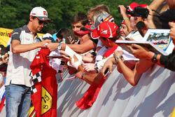 Esteban Gutierrez, Haas F1 Team signs autographs for the fans