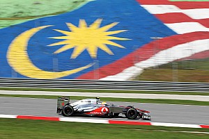 Formula 1 Hamilton turns hot laps to snatch Malaysian GP pole in Sepang
