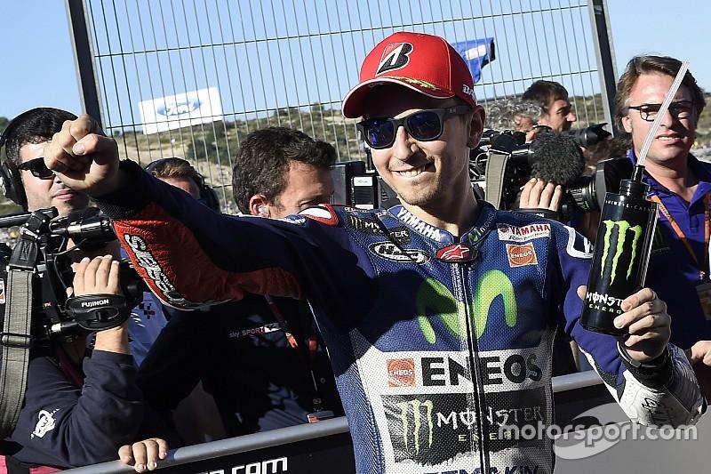 Valencia MotoGP: Lorenzo grabs pole for title decider, Rossi crashes