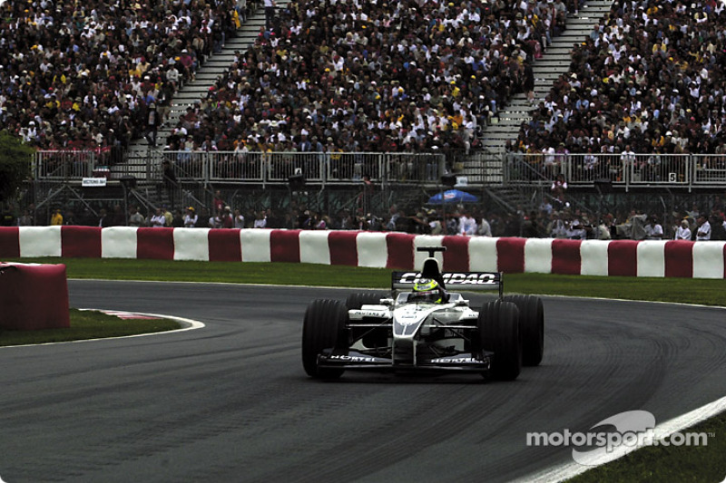 Ralf Schumacher trying as hard as possible while the rain is starting to fall