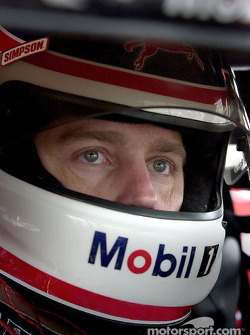 Jeremy Mayfield keeps a eye on the skies as rain forced the cancelation of qualifying at Dover
