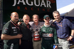 Eddie Irvine celebrating his 3rd place with Bobby Rahal and the Jaguar team