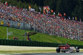 Michael Schumacher and the tifosi, always in great number in Austria