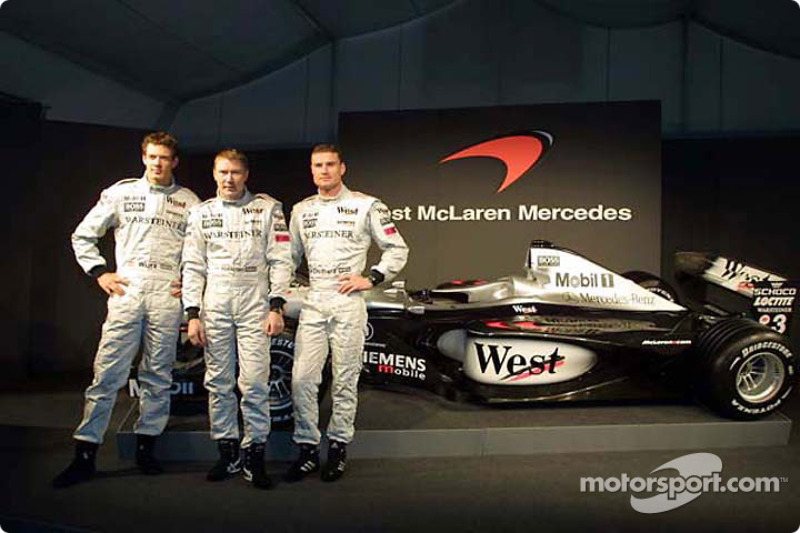 Test driver Alexander Wurz, and the two drivers Mika Hakkinen and David Coulthard