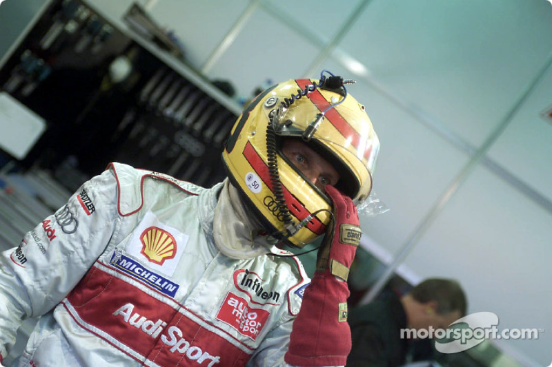 Frank Biela waits in the Audi Sport Team Joest pits for his next stint