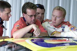 Ricky Craven and crew chief Mike Beam check the set up notes during practice