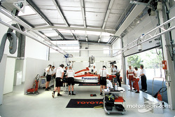 The Toyota F1 and Mika Salo in the garage