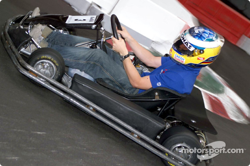 Nick Heidfeld having fun with a kart