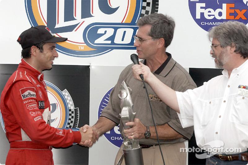 The podium: Helio Castroneves