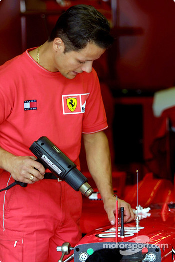 Team Ferrari crew taking the sponsors logos off the car, Ferraris will race with no logos at Monza to share a sense of grief with the American people