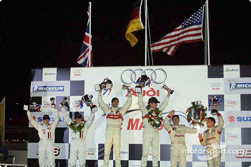 LMP900 podium: Emanuele Pirro and Frank Biela, with Patrick Lemarié, Stefan Johansson, Johnny Herbert and Andy Wallace