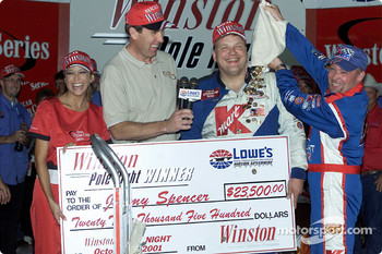 Todd Bodine pours dollar coins over teamate Jimmy Spencer, the pole winner