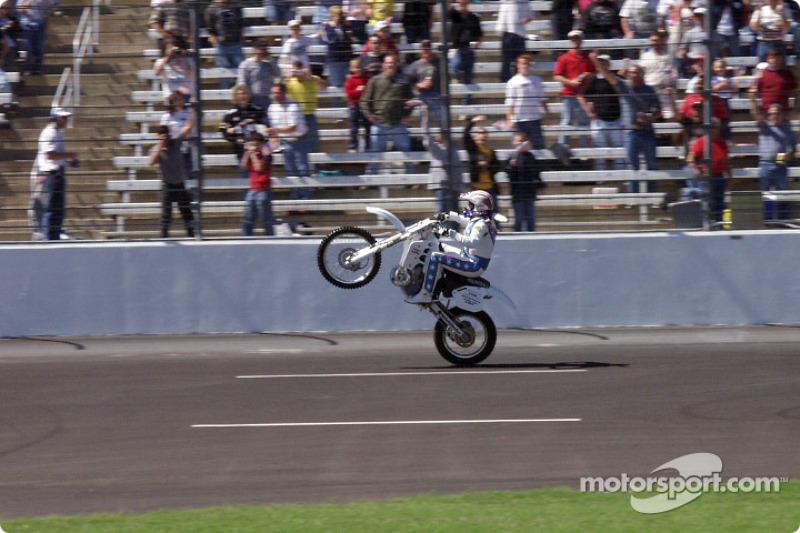 Robbie Knievel does a tri-oval long wheelie