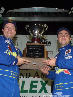 Doug Goad and Devon Powell hoist the SGS team owner championship trophy in Victory Lane at Daytona International Speedway