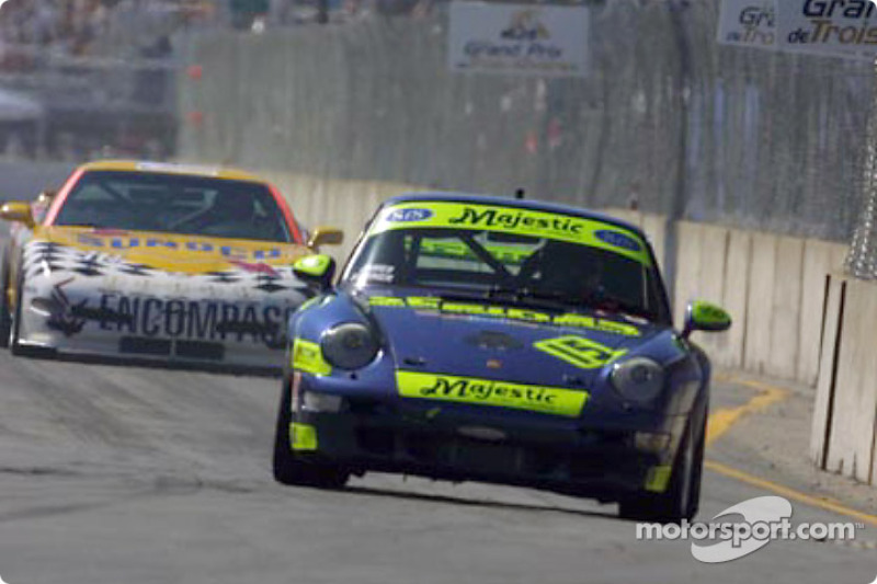 The #15 Motorsport Technologies Porsche leads the Powell Motorsports Corvette through the streets of Trois-Rivières