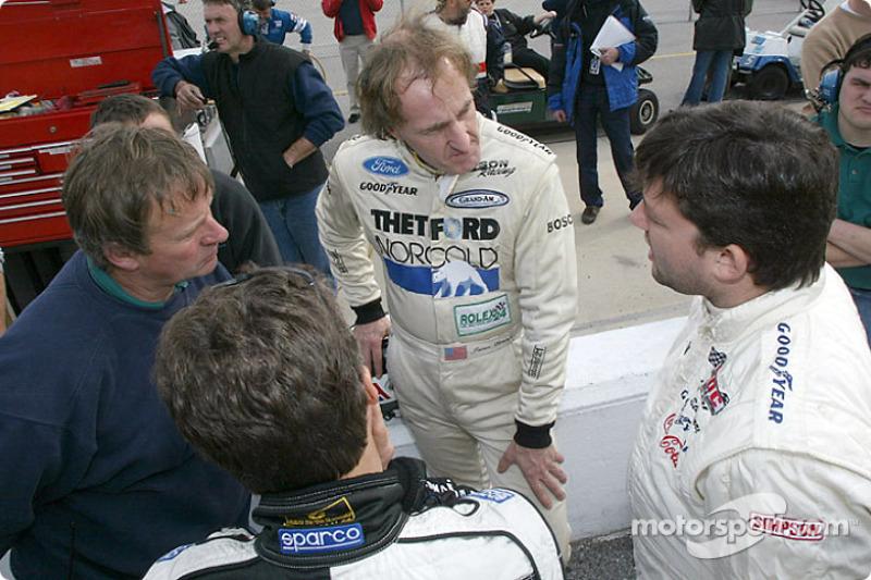 Tony Stewart (right) talks with James Weaver and Jan Lammers at Daytona Grand-Am testing on Saturday