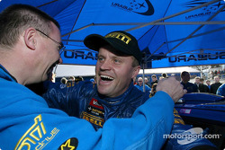 Tommi Makinen celebrating with SWRT Sporting Director George Donaldson