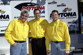 Comedian Jay Leno, Firebird Brand Manager Bob Kraut and Pontiac NASCAR Winston Cup driver Tony Stewart unveil the official 2002 Daytona 500 pace car