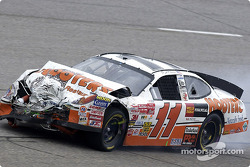 The Hooters Ford Taurus of Brett Bodine limps back to pit road after an accident