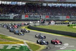 First corner: Michael Schumacher passing Juan Pablo Montoya