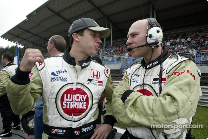 Olivier Panis and engineer David Lloydd on the grid