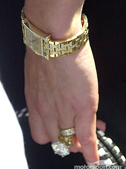 A solid gold watch and a diamond large enough to choke a horse, must be some serious money near by…