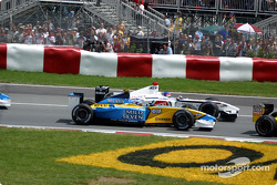 First corner: Jarno Trulli and Jacques Villeneuve