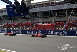 Rubens Barrichello taking the checkered flag in front of Michael Schumacher