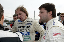 Tony Stewart standings with two-time Rolex Series champion James Weaver in the pits during testing for the Rolex 24 At Daytona