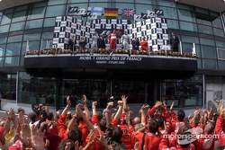 The podium: race winner Michael Schumacher with Kimi Raikkonen and David Coulthard
