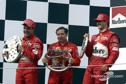 The podium: race winner Rubens Barrichello with Jean Todt and Michael Schumacher