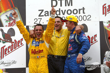 The podium: race winner Mattias Ekström with DTM 2002 Champion Laurent Aiello and Hans-Jürgen Abt