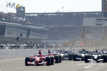 The start: Michael Schumacher takes the lead