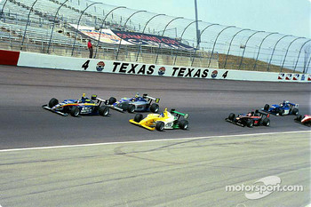 Ed Carpenter leads a group of cars