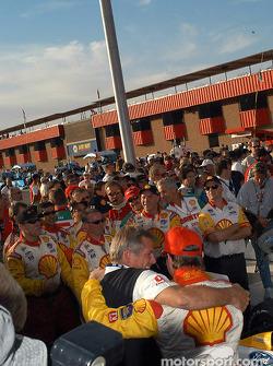 Race winner Jimmy Vasser celebrates