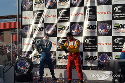 The podium: champagne for Jimmy Vasser and Patrick Carpentier