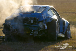 The wrecked #68 The Racers Group Porsche GT3 RS