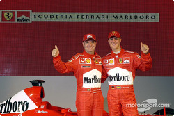 Michael Schumacher and Rubens Barrichello with the new Ferrari F2003-GA