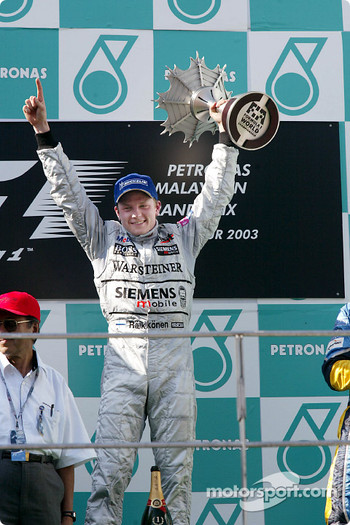 The podium: race winner Kimi Raikkonen
