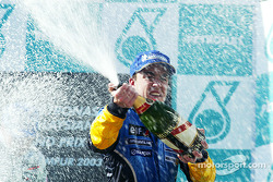 The podium: champagne for Fernando Alonso