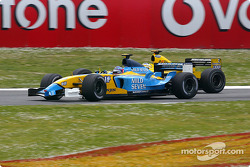 Jarno Trulli battles with Giancarlo Fisichella