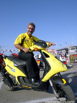 Eddie Jordan on his Piagio moped