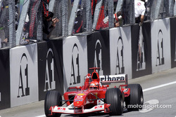Race winner Michael Schumacher celebrates victory